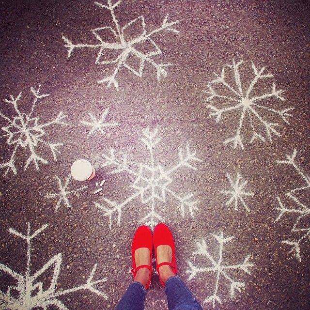 No two are alike. Cheap & easy way to decorate side walk/walk way -chalk snow flakes