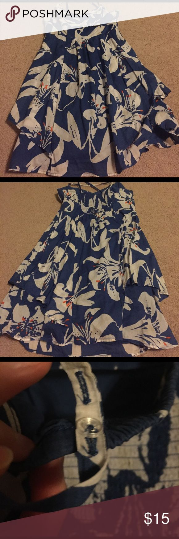 Floral American Eagle Outfitters dress Love this dress however I don't fit it anymore. It's in dark blue with white and orange flowers. It's a crossback strap style and you can adjust them in the back with the buttons. Like new condition with no damage. American Eagle Outfitters Dresses Midi