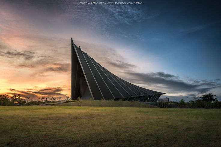 Prince Mahidol Hall (Golden Twilight Shot) - Prince Mahidol Hall, the new Mahidol University's hall built with Unique Modern Design inspired from Traditional Thai Architecture. Most University Students would come to take a photo here before graduation.