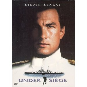 That's just what cook and ex-Navy SEAL Steven Seagal is, when a group of terrorists led by psychotic CIA operative Tommy Lee Jones commandeers the battleship U.S.S. Missouri and nuclear arsenal, forcing him to use his martial arts and military skills to stop them. Action smash co-stars Erika Eleniak, Gary Busey, and Patrick O'Neal.