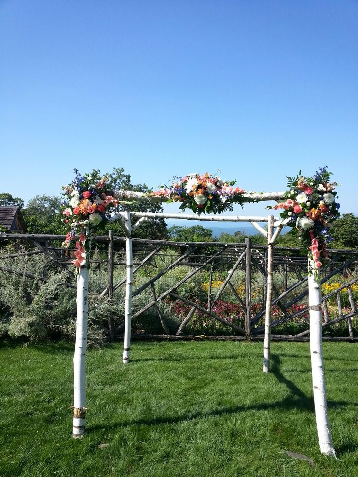 Coral, Peach And White Flowers Grace The Birch Trellis In The Mountain View  Garden At