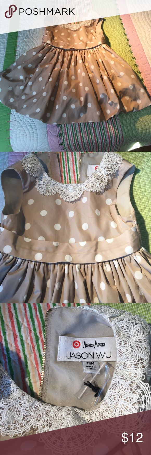 Neiman Marcus, Jason Wu for Target girl's dress. Beautiful cream dress with white polka dots. It is lined in cream acetate and it has a lace cream colar. Beautiful dress. Neiman Marcus Dresses Formal
