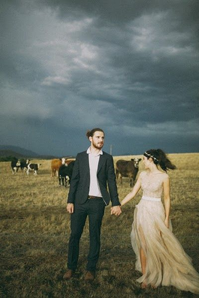 brown paper parcel photography - this is LIT'RALLY the greatest shoot I could imagine - cows, dark skies, perfect dress, handsome man with a bun.....