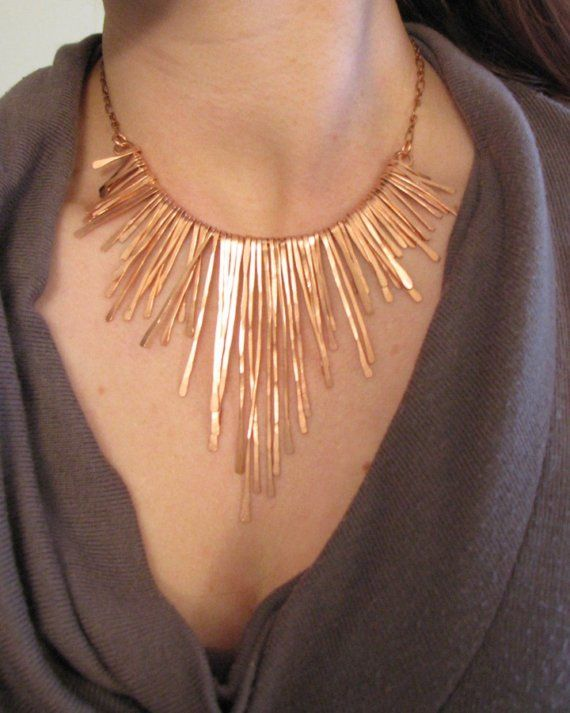 Dress up a simple black dress or top with this eye catching gold necklace