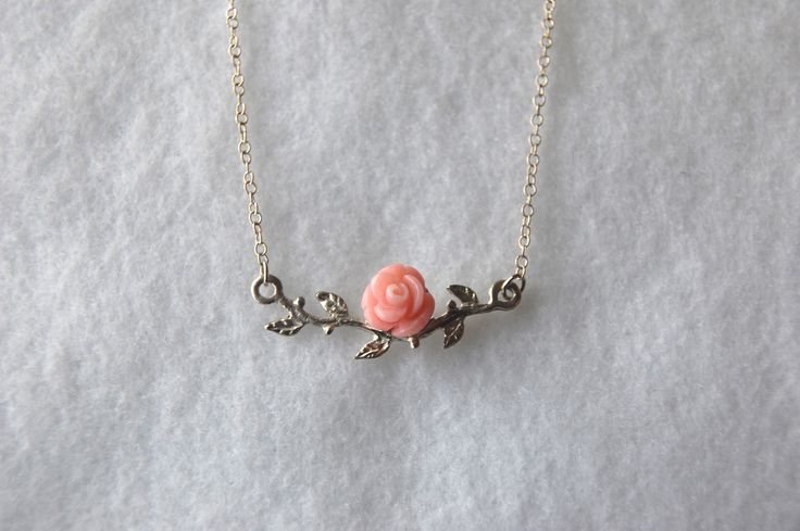 Sterling silver branch with carved pink bamboo coral rose hanging off a fine chain.  www.jewelrybysaveria.com