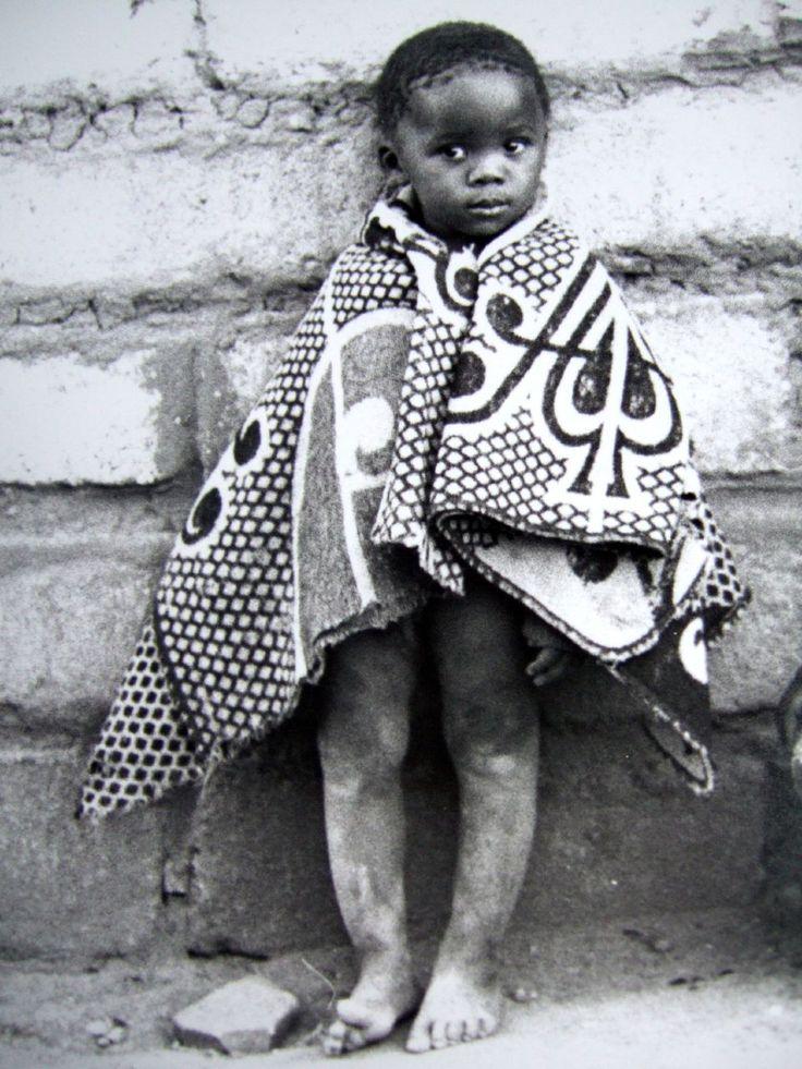 Africa | Retsilisitsoe Nthunya wrapped in a traditional Basotho blanket.  Lesotho | ©K Kendal