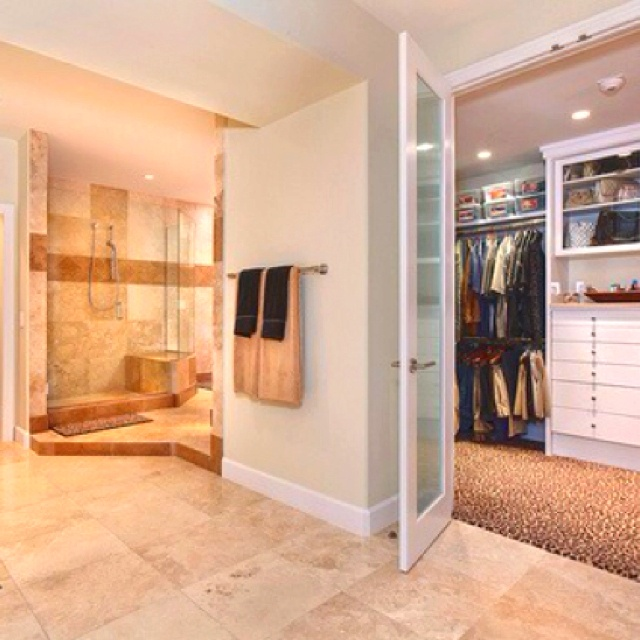 bathroom with large walk in closet. attached this is a great idea.  most people get dressed after washing up, so it makes more sense to have the clothing access right there instead of crossing back through a bedroom to get the necessary items in the morning