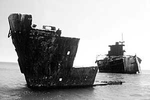 TheAlkimos shipwreck, Australia: The Alkimos was a greek owned merchant ship which was wrecked on the coast of Perth Western Australia in 1963. The wreck is a popular diving venue, and is also reputed to be haunted, making it of interest to ghost hunters. The ship was built during world war II by Bethlehem-Fairfield Shipyards in Baltimore as part of the United States' Liberty ship program and was originally scheduled to be named George M. Shriver. It was launched on Oc