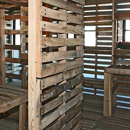 A house made out of wooden shipping pallets.