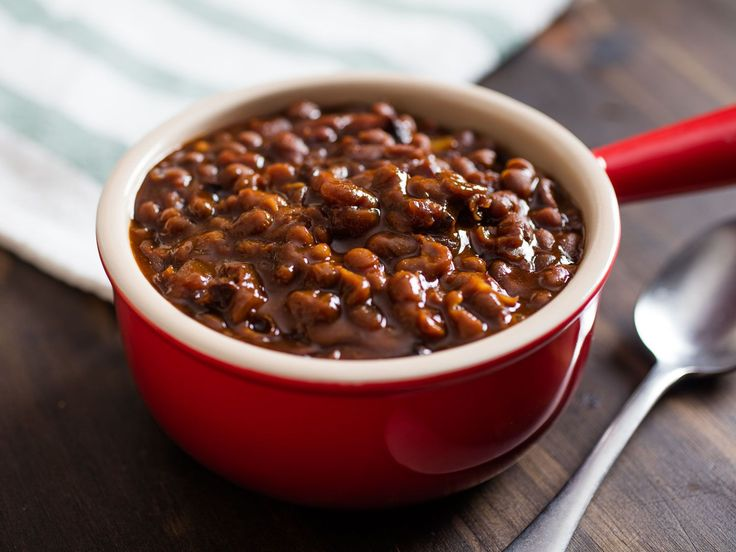 Pure and Simple Slow-Cooked Boston Baked Beans Recipe ● Boston baked beans, one of the most famous of many versions of baked beans to come out of New England, stars very few ingredients, the main ones being no more than beans, molasses, and salt pork. The secret is a long, slow cook in a dry oven to gently tenderize and partially break down the beans, while a deep, dark crust forms on top for the best possible flavor.