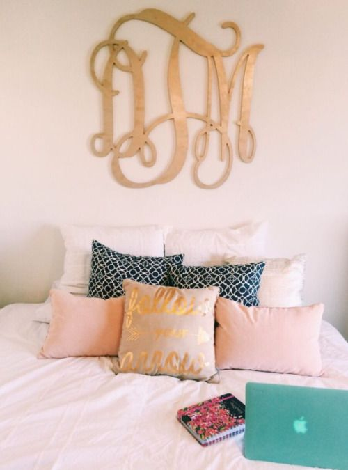 gold monogram over the bed