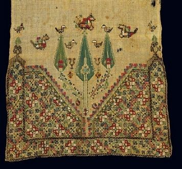 Detail of the embroidery on a bridal towel with stylised floral decoration, cypress trees, and birds. From Argyrokastro in Northern Epiros, today part of Albania, 18th-19th c. 0.71x0.39 m. Gift of Eleni Efkleidi.