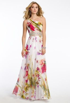 It's a floral dreamland of style! We're so in love with this gorgeous one shoulder gown the moment we first set eyes...and we're sure you'd love it too! Features include a wonderfully pleated bodice and skirt, a well-designed beaded empire detail and single strap open back. The chiffon pleated skirt gives off a wispy, flared silhouette as you glide through the dance floor. So beautiful from every angle! Wear this dress to Prom, Weddings and several other special celebrations. It is truly a…
