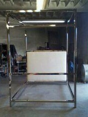 nickel canopy bed custom made by Storm for a client in NYC: pictured assembled and will be disassembled for shipping