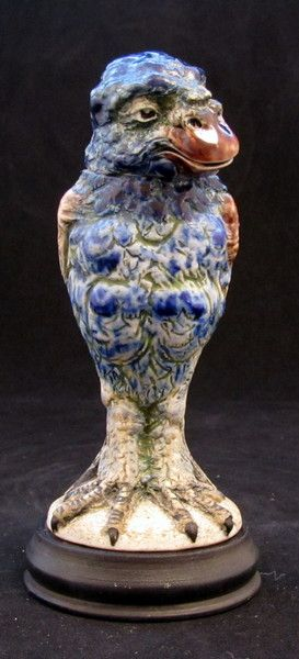 """Martin Brothers tobacco jar modelled as a grotesque bird in a blue colourway. The bird is ex Harriman Judd sale and stands 7"""" including the base."""