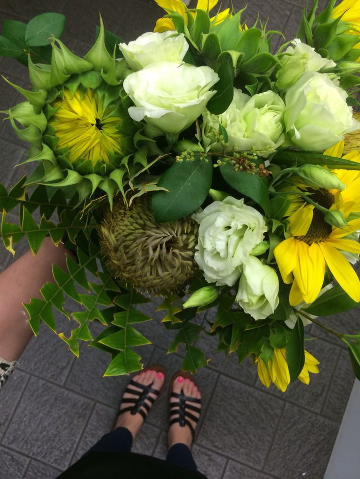 A gorgeous bouquet of sunflowers, lisianthus, and natives