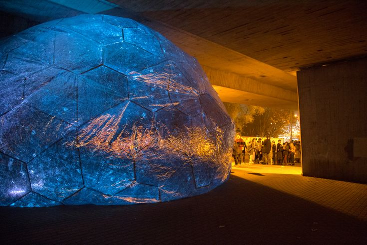 London-based studio Loop.pH has conceived OSMO, a 9M sphere inflated that re-creates the cosmos under the A13 flyover for the latest edition of Light Night Canning Town.