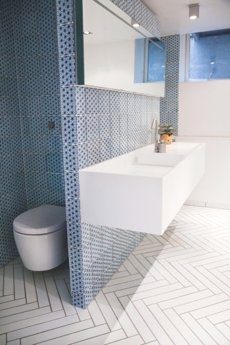 bathroom - love the sleek (easy to clean) toilet,  and the chevron tiled floor (with grout- not so easy to clean)