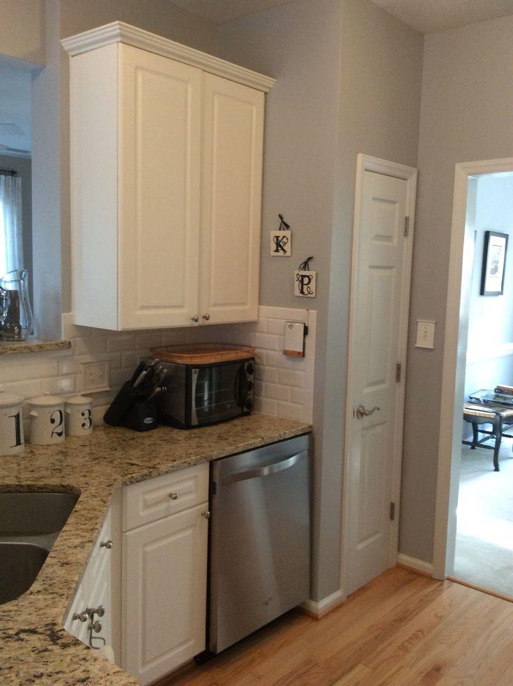 Sherwin Williams Lazy Gray, white beveled subway tile backsplash, giallo ornamental granite for small kitchen