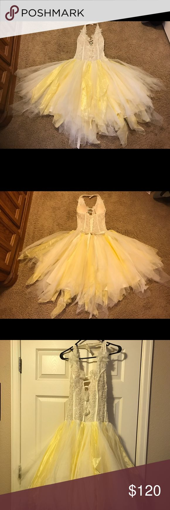 Beaded tule prom dress Handmade beaded tule formal dress. Tule skirt with various yellow and creme pieces in varying lengths. Beaded halter top with tule flowers. Worn once. Corset backing with bra inserts. Bra inserts need to be sewn back in. Hits mid calf fluffy skirt with tighter fit top. Likely fits size 0-2. Any questions or additional pics please ask! Very good condition needs to breathe and be fluffed but should hang very nice once on. Dresses Prom