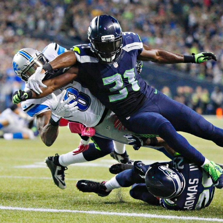 Kam Chancellor with the help of Earl Thomas saves the Seahawks in win over Detroit...