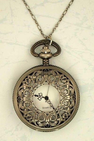I adore pocket watch necklaces. They're such a cute idea.