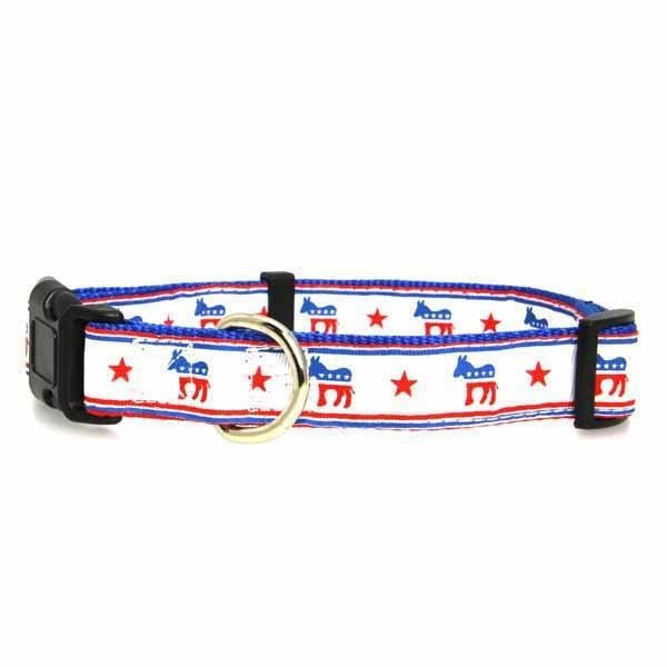 Democratic Party Nylon Dog Collar. Show your support this election season with a Democrat Party Dog Collar!Adjustable!Plastic buckleInside nylon features bold patriotic stripesFeatures Democrat donkeyMade in the U.S.A.Why We Love It:We love the red, white, and blue donkey emblems along the ribbon! The Democrat Party Nylon Dog Collar is a nylon collar featuring a sewn-on ribbon emblazoned with the Democrat Party's signature symbol. Thick plastic hardware and a sturdy metal D-ring...