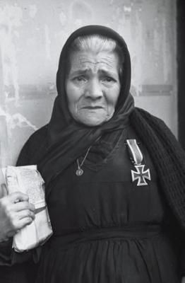 The mother of a spanish soldier of the Division Azul killed in action in Russia whit the iron cross.