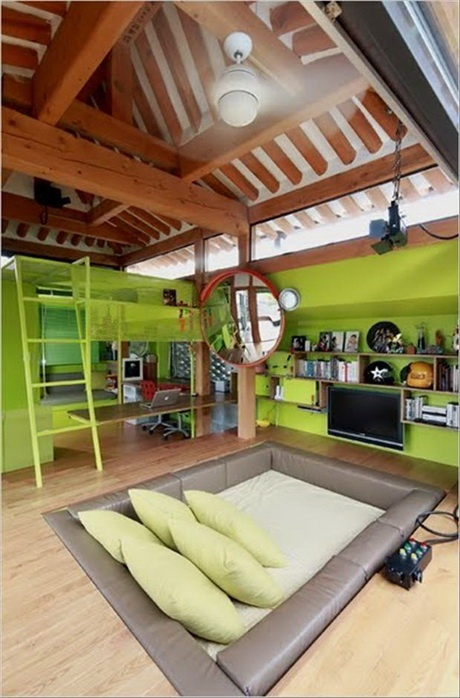 love the sunk-in couch and the loft bed/work space. and the color!