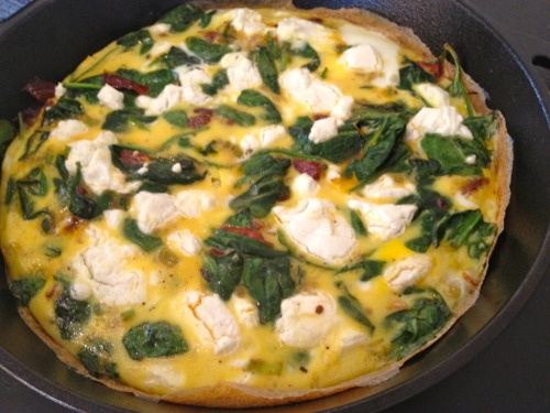 Open-faced goat cheese, spinach, and sun-dried tomato omelette