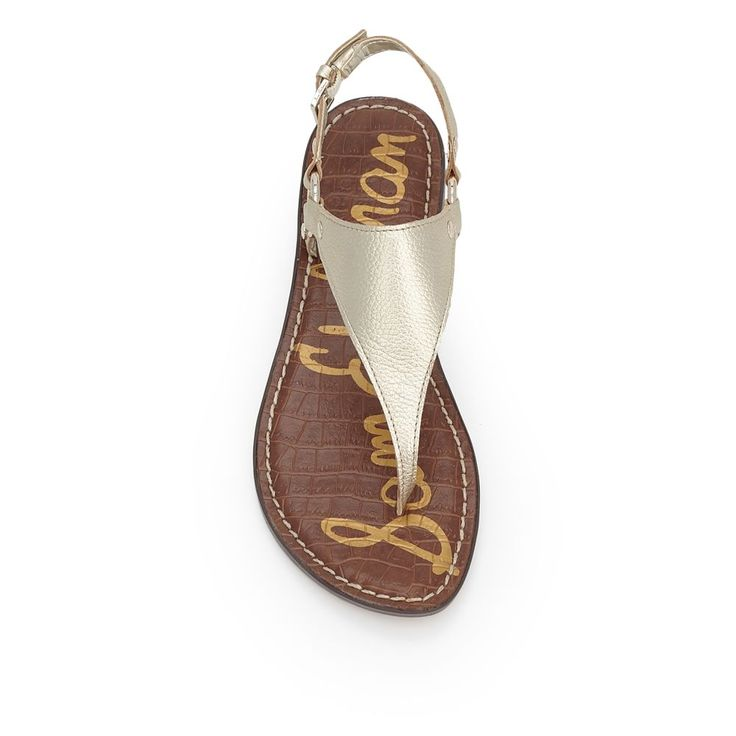 The Greta thong sandal is crafted from luxe pebbled leather bound on each side by chic gold rings, elevating all your warm-weather looks from denim to dresses. The Greta sandal features adjustable ankle strap and signature padded croco sock.Material: Nubuck Leather or Tumble Leather