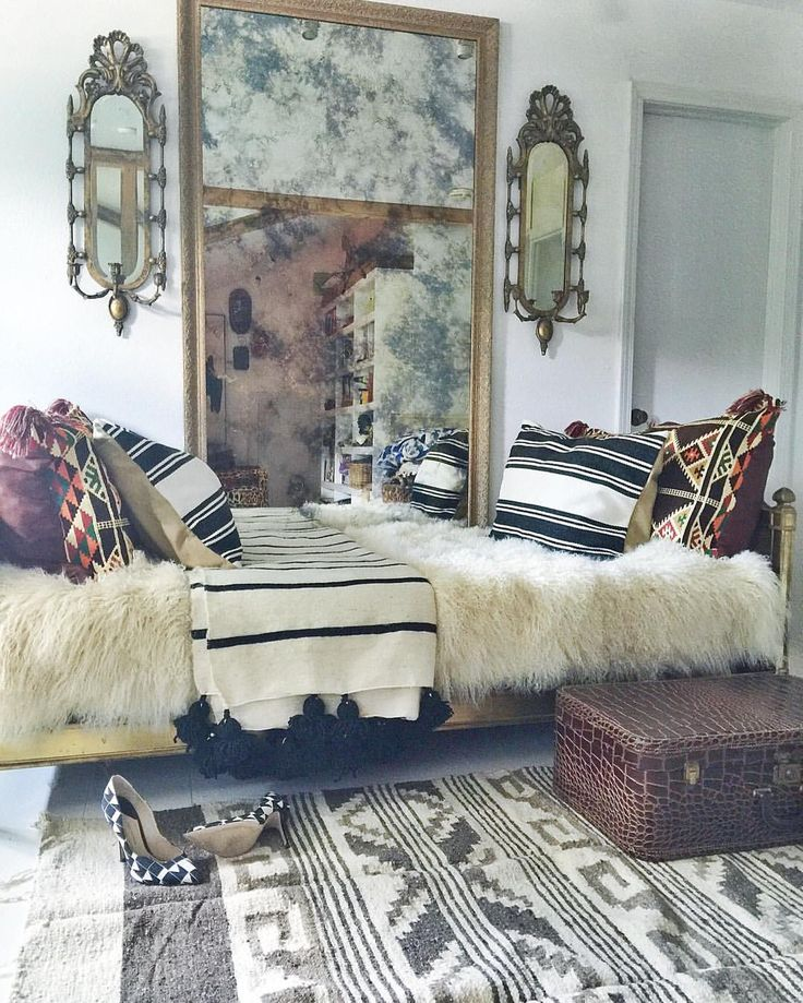 Inviting daybed, antique mirrors/ Judy Aldridge