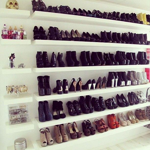 Wall of shoes! Cheap shelves from IKEA. looks like a retail store