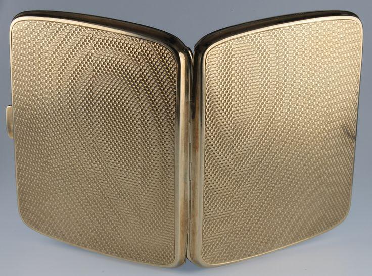 Lot 1003, A 9ct gold engine turned cigarette case with presentation inscription 88 grams, est  £800-1000