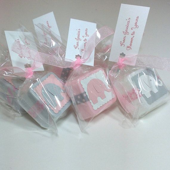 Elephant baby shower favors, made with handmade shea butter mini soaps. They are shown in light pink, pink and grey in the main picture but are available to match any color theme. These soaps measure approximately 1 1/4 across and are about 1/2 thick. They weigh approximately 1 oz each. Each favor comes with an ingredients label so your guests know what is in their soap. These are also available in 2-4 ounce soaps. (message me for more info)  --Orders of 36+ come packaged in nice bo...
