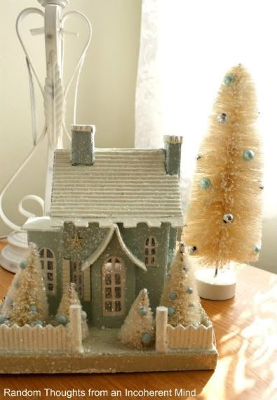 puts house- I one the roof/ picket fence/ trees/ double chimneys- RRM