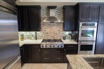 Moorpark Residence mediterranean cooktops *** vent hood between cabinets