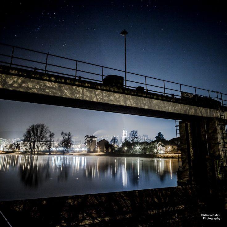 Dam at night, with Dietikon Skyline across the Limmat.