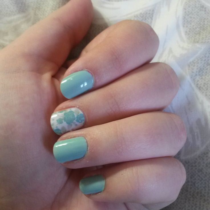 Flower design accent nail is a Jamberry nail wrap, the rest of my nails are painted with regular polish! Send me a message if you want pretty nails too!