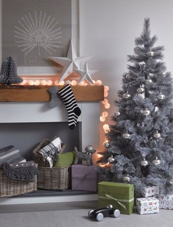 Outdoor sphere lights as mantel lights/decor and gray Christmas tree