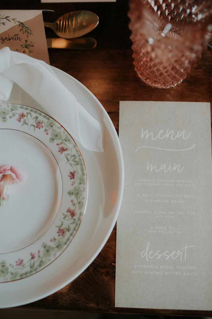 Tease your guests' appetite with a beautiful menu... Venue: 8th & Main Event Space | Photo: Mon Photography KC | Floral: Jones & Co. Flowers | Gown: Stephanie's Bridal Boutique | Hair & Makeup: White Carpet Bride | Rentals: Ultrapom & All Seasons | Airstream: Photo Stream | Catering: Summit Hickory Pit BBQ | Specialty Dessert: Cottontale KC | Jewelry: Rodgers Jewelry | Paperie: Yellow Brick Graphics | DJ & Lighting: Platinum KC | Cake: Blue Thistle Cakes