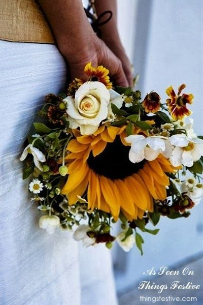 Beautiful fall wedding bouquet sunflowers, greenery, maroon and white roses