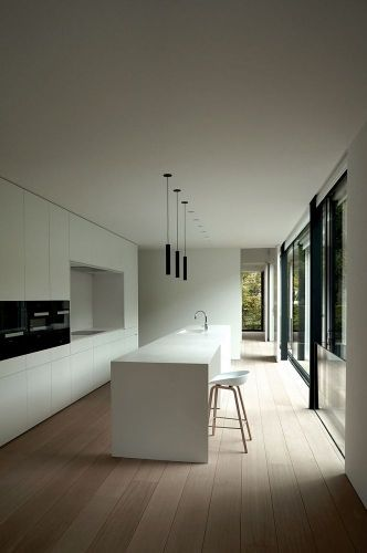 INSPIRATION: A compilation of height, white and light succeed in this streamlined kitchen setting | est living