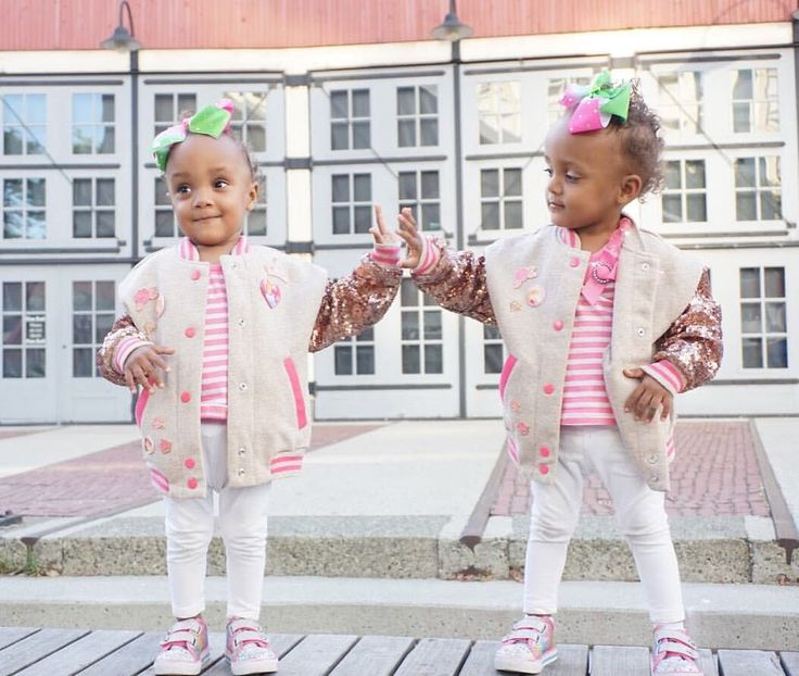 Twin sisters in their sparkle Disney Bombers