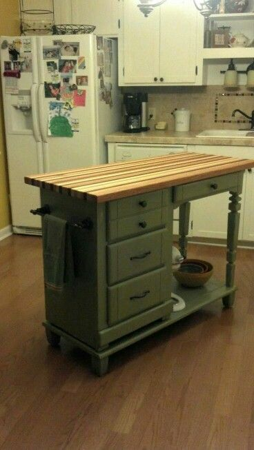Desk to kitchen island with Butcher block top.