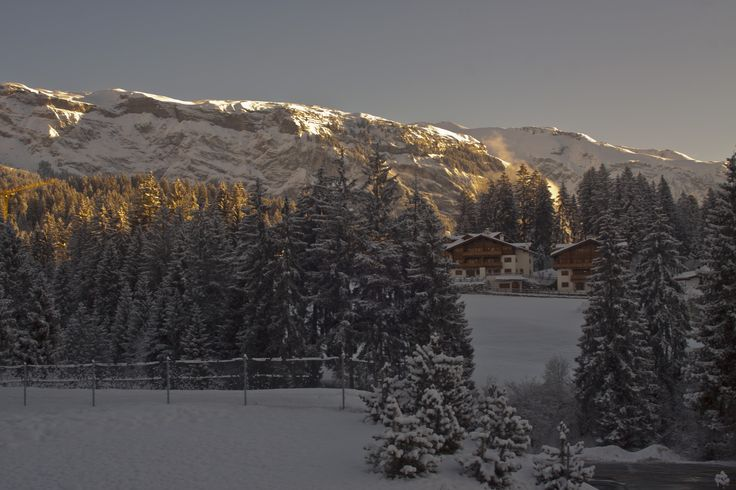 View from our the balcony of our rooom in the Hotel Signina, Laax, Graubunden, Switzerland, on the first day after it had snowed overnight, looking straight up at the mountains