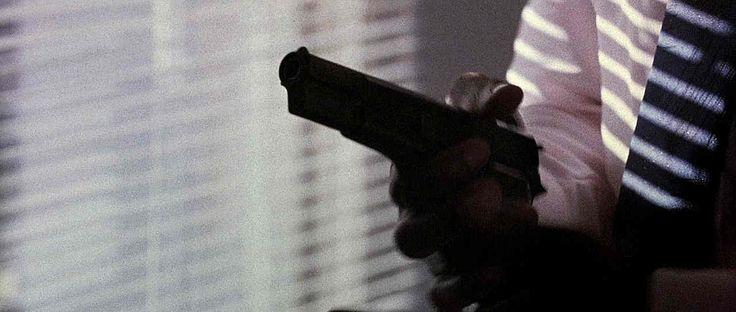 Closeup as Axel (Eddie Murphy) loads his pistol in Beverly Hills Cop II
