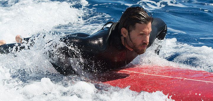 Warner Bros. has released the first two photos from their upcoming remake of the action thriller Point Break.