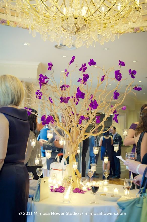 Good idea...but different colors...very dramatic and would look good in the Great Hall at the Museum - Manzanita Branches Purple Vanda Orchids - Wishing Tree -