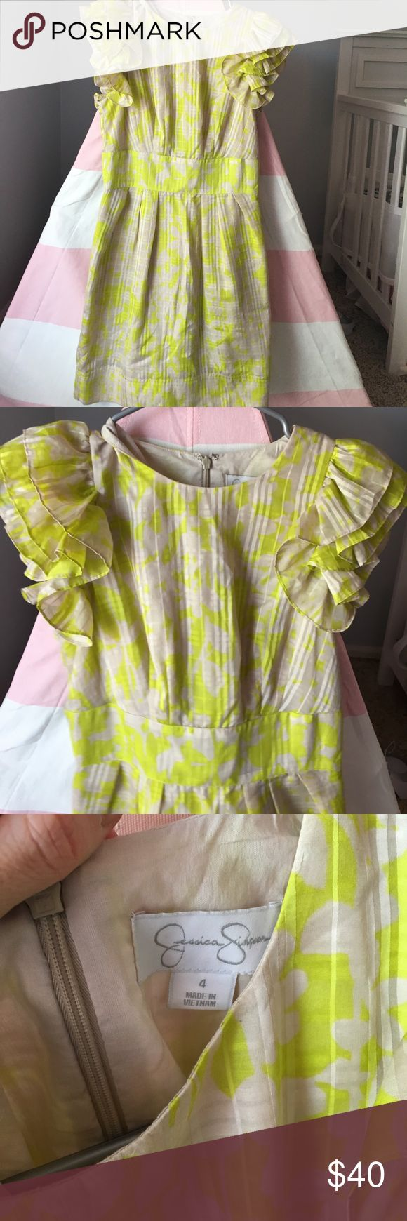 Jessica Simpson Yellow and grey party dress So cute. The print & ruffled sleeves make this dress. I've received so many compliments wearing this. Jessica Simpson Dresses Mini
